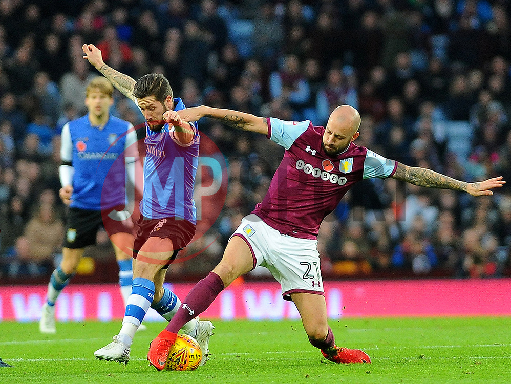 Alan Hutton of Aston Villa tackles Jacob Butterfield of Sheffield Wednesday- Mandatory by-line: Nizaam Jones/JMP - 04/11/2017 - FOOTBALL - Villa Park - Birmingham, England - Aston Villa v Sheffield Wednesday - Sky Bet Championship