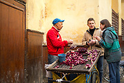 Fez, Morocco - 1st FEBRUARY 2018 - Barbary fig (prickly pear cactus fruit) Moroccan street food vendor, old Fez Medina, Middle Atlas Mountains, Morocco.