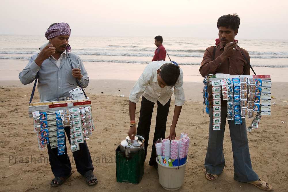 """A 'Paan Walla"""" (a seller of tobacco,ciggaretts and other chewing products) sells chewing Tobacco products at a beach in Mumbai, India, on Thursday, Feb. 19, 2009.. Photographer:.Prashanth Vishwanathan/Bloomberg News"""