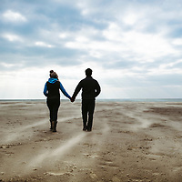 Man and woman walking on a beach