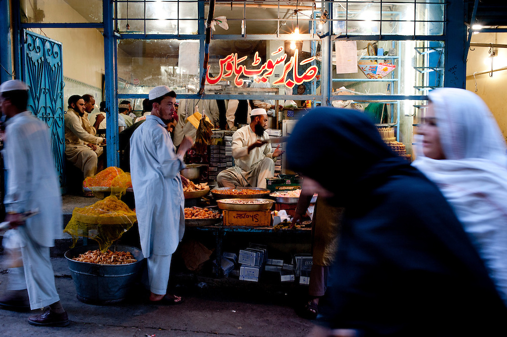 A stall selling desserts in a busy commerical district of Abbottabad, Khyber Pakhtunkhwa province, Pakistan on May 5, 2011. US special forces launched an agressive attack on the compound early morning on May 2 killing Osama bin Laden.