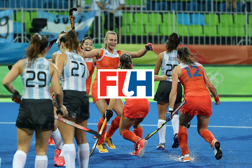 RIO DE JANEIRO, BRAZIL - AUGUST 15:  Laurien Leurink #6 (C) of Netherlands celebrates with teammates after scoring a first half goal against Argentina during the quarter final hockey game on Day 10 of the Rio 2016 Olympic Games at the Olympic Hockey Centre on August 15, 2016 in Rio de Janeiro, Brazil.  (Photo by Christian Petersen/Getty Images)