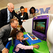At the Borough of Manhattan Community College on Wednesday, March 21, 2012, the City University of New York (CUNY) thanked IBM for donating 45 Young Explorer computers to help the children of CUNY students on 14 campuses learn key concepts in math and science. Kneeling is Stanley S. Litow, IBM's vice president of Corporate Citizenship and Corporate Affairs, and president of IBM's International Foundation. Standing, from left, is CUNY Chancellor Matthew Goldstein; CUNY Director of Child Care Betty Pearsall; and BMCC's Board of Directors Chairperson Dr. Emily Anderson. (Feature Photo Service)