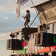 Woman dancign on the LedHedz bus at AfrikaBurn 2014, Tankwa Karoo desert, South Africa