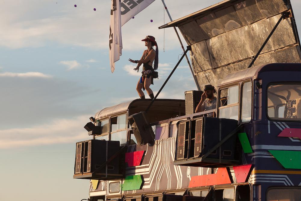 Woman dancign on the LedHedz bus at AfrikaBurn 2014, Tankwa Karoo desert, South Africa