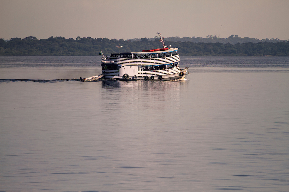 Boat sailing down the Rio Negro river, in the Amazon, Brazil.