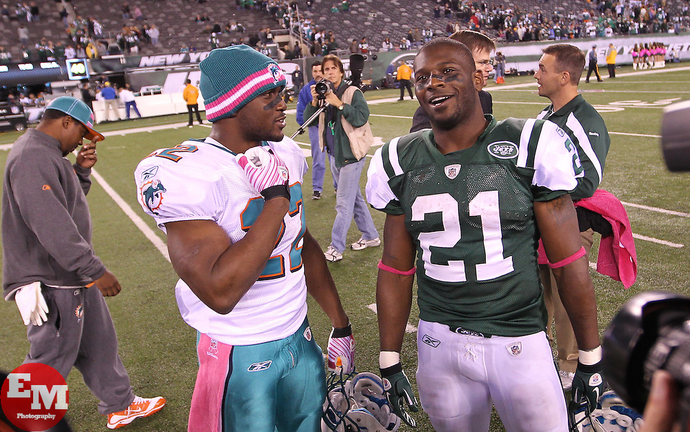 October 17, 2011; East Rutherford, NJ, USA; New York Jets running back LaDainian Tomlinson (21) and Miami Dolphins running back Reggie Bush (22) talk after the Jets win over the Dolphins at the New Meadowlands Stadium. The Jets defeated the Dolphins 24-6.