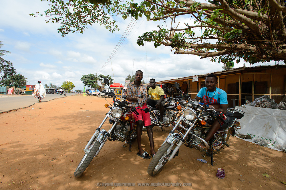 Okada (motorcycle taxi) riders waiting for fares in Sogakope in the Volata Region of Ghana.