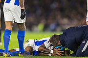 Gaetan Bong (Brighton) receiving treatment from Brighton Doctor during the Premier League match between Brighton and Hove Albion and Burnley at the American Express Community Stadium, Brighton and Hove, England on 9 February 2019.