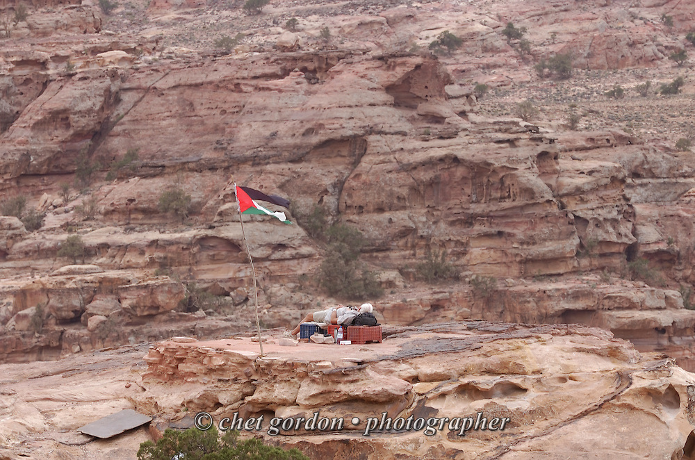 Jordanian man rests at this lookout point in the ancient city of Petra, Jordan on April 28, 2006. Petra is considered the most famous and gorgeous site in Jordan located about 262 km south of Amman and 133 km north of Aqaba. It is the legacy of the Nabataeans, an industrious Arab people who settled in southern Jordan more than 2000 years ago. Admired then for its refined culture, massive architecture and ingenious complex of dams and water channels, Petra is now a UNESCO world heritage site that enchants visitors from all corners of the globe.