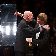 March 7, 2012 - New York, NY : Conductor Christoph Eschenbach, left, and pianist Cédric Tiberghien embrace after performing Maurice Ravel's 'Piano Concerto in G Major (1929-1931)' with the Boston Symphony Orchestra in the Isaac Stern Auditorium at Carnegie Hall on Wednesday night. CREDIT: Karsten Moran for The New York Times