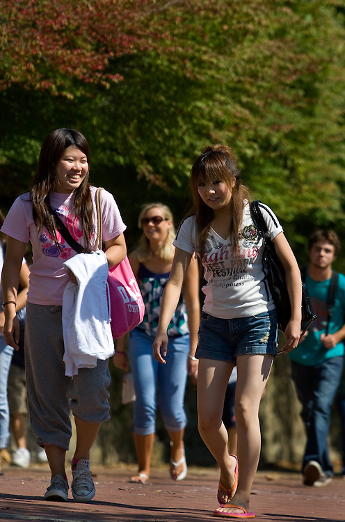 08-19070     From left, Ayaka Fuwa and Chisato Nagakura, both sophomore students from Japan, climb Morton Hill on their way to class, on Wednesday, September 24.