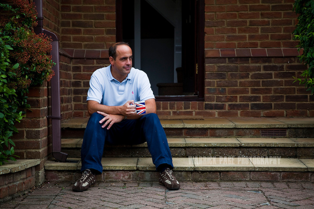 Julio sits on the steps of his new home, on September 1, 2012, in Buckden, England. The Spanish family immigrated to England due to the ongoing economic crisis that has impacted heavily on Spain. (Photo by Warrick Page)
