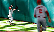 Jun 22, 2016; Houston, TX, USA; Los Angeles Angels center fielder Shane Robinson (17) can't catch Houston Astros first baseman Marwin Gonzalez (9) (not pictured) RBI triple fly ball in the eighth inning at Minute Maid Park. Mandatory Credit: Thomas B. Shea-USA TODAY Sports