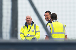 © London News Pictures. 06/06/2012. Luton, UK.  England and Chelsea defender John Terry shares a joke with airport workers as he boards a plane at Luton Airport in Bedfordshire on June 6, 2012 to head to Poland for the Euro 2012 football tournament. The squads training camp is based in Krakow.  Photo credit: Ben Cawthra/LNP
