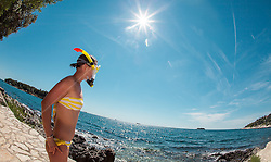 THEMENBILD - URLAUB IN KROATIEN, eine junge Frau genießt die Sonne und macht sich zum Schnorcheln bereit, aufgenommen am 03.07.2014 in Vrsar, Kroatien // a young woman enjoying the sun and makes itself ready for snorkeling near Vrsar, Croatia on 2014/07/03. EXPA Pictures © 2014, PhotoCredit: EXPA/ JFK