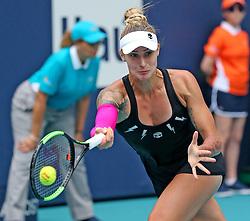 March 24, 2019 - Miami, FL, USA - Polona Hercog returns a ball hit by Simona Halpen on Sunday, March, 24, 2019 at the Miami Open in Miami Gardens, Fla. (Credit Image: © Charles Trainor Jr/Miami Herald/TNS via ZUMA Wire)