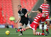Photo: Paul Thomas.<br /> Doncaster Rovers v Swansea City. Coca Cola League 1. 17/02/2007.<br /> <br /> Ian Craney (L) of Swansea gets by Graeme Lee.