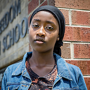 WOODBRIDGE,VA-JUN8: Fatmata Mansaray, outside Freedom High School, in Woodbridge, Virginia, June 8, 2017. Fatmata said she has been harassed by administrators every time she wore a hijab and eventually had to obtain a note from an assistant principal that she could show to officials who told her to remove the head covering. Hajah began wearing a hijab last week for Ramadan, leading to a confrontation with an administrator who threatened to write her up when she refused to remove it and protested. School administrators have since apologized to both young women and their families. (Photo by Evelyn Hockstein/For The Washington Post)