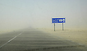 A sandstorm covers the highway in the desert of Kuwait.