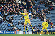 Milton Keynes Dons defender Kyle McFadzean (5) clears during the Sky Bet Championship match between Preston North End and Milton Keynes Dons at Deepdale, Preston, England on 16 April 2016. Photo by Pete Burns.
