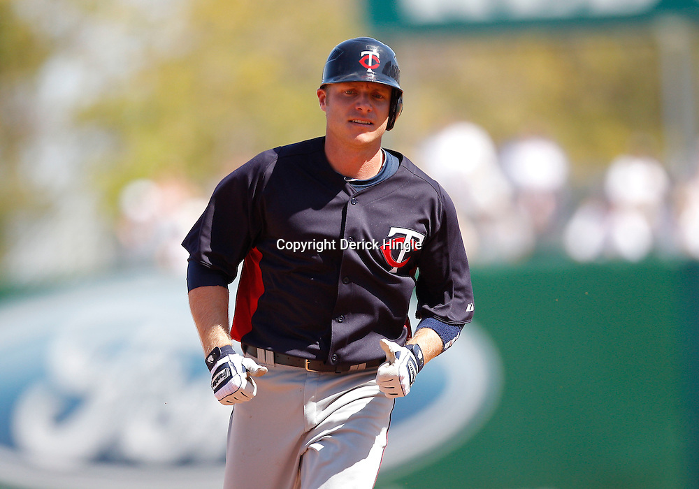 February 28, 2011; Fort Myers, FL, USA; Minnesota Twins third baseman Luke Hughes (38) rounds the bases after hitting a homerun during a spring training exhibition game against the Boston Red Sox at City of Palms Park.  Mandatory Credit: Derick E. Hingle