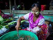 21 NOVEMBER 2017 - PANTANAW, AYEYARWADY REGION, MYANMAR: A woman sells curry paste in the market in Pantanaw, a town near Pathien in the Ayeyarwady delta.    PHOTO BY JACK KURTZ