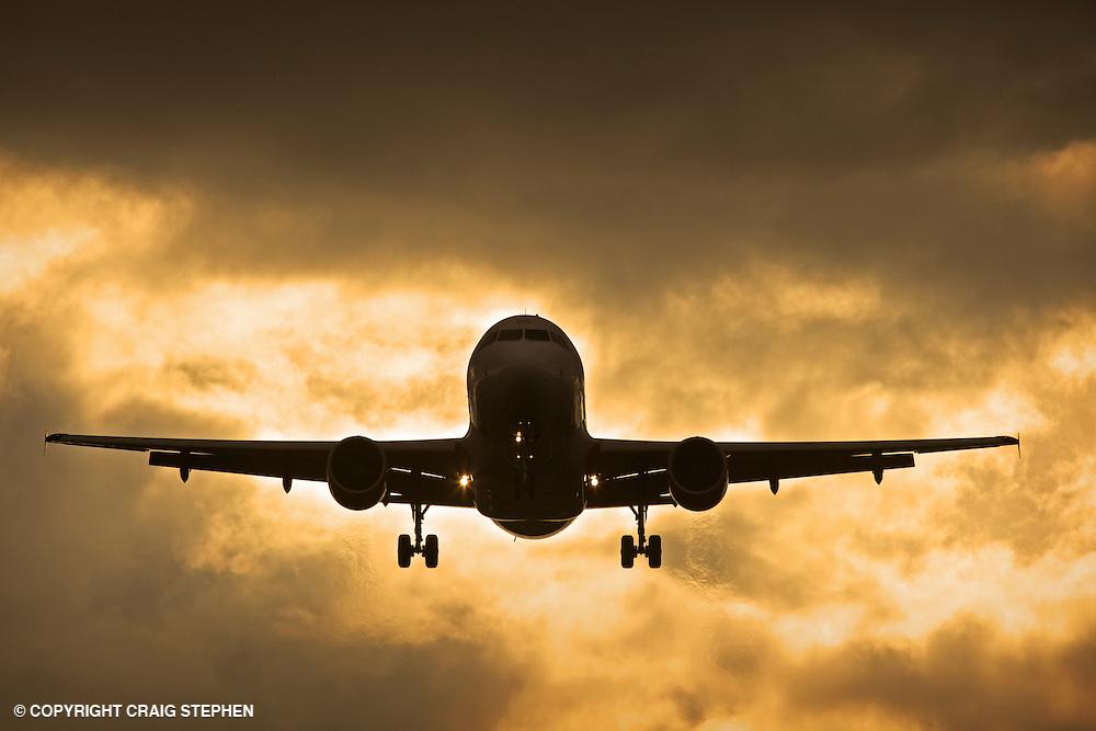 A plane approaching Edinburgh airport, Scotland, UK