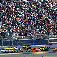 Sprint Cup Series driver Dale Earnhardt Jr. (88) leads down the backstretch during the Daytona 500 Sprint Cup Race at Daytona International Speedway on February 20, 2011 in Daytona Beach, Florida. (AP Photo/Alex Menendez)