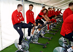 CARDIFF, WALES - Monday, September 3, 2018: Wales' Ben Woodburn, Tyler Roberts and Ethan Ampadu on warm-up bikes in the pre-activation tent before a training session at the Vale Resort ahead of the UEFA Nations League Group Stage League B Group 4 match between Wales and Republic of Ireland. (Pic by David Rawcliffe/Propaganda)