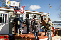 Derby Headquarters in Meredith saw a brisk business with anglers registering for the Meredith Ice Fishing Derby this weekend.  (Karen Bobotas/for the Laconia Daily Sun)
