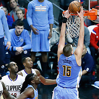 26 December 2016: Denver Nuggets forward Nikola Jokic (15) goes for the dunk during the Denver Nuggets 106-102 victory over the LA Clippers, at the Staples Center, Los Angeles, California, USA.