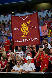 "MUNICH, GERMANY - Tuesday, August 1, 2017: A Liverpool supporter with a banner ""1892-2017 LFC 125 Years"" during the Audi Cup 2017 match between FC Bayern Munich and Liverpool FC at the Allianz Arena. (Pic by David Rawcliffe/Propaganda)"