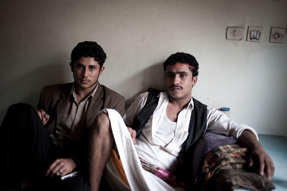 Two young men working at a restaurant settle in for an afternoon of qat chewing in the town of Manakha,  in the Jebel Harraz region of Yemen, west of the capital Sana'a on 22nd June, 2010. Qat is a native flowering plant to East Africa and the Arabian Peninsula. Predating the consumption of coffee in Yemen, it is consumed by 90% of Yemeni men and 40% of Yemeni women, chewed in large quantities for its mildly euphoric sensation. The country produces vast quantities of the plant, with a growth rate of 10% per year as well as importing from neighbouring Ethiopia. But with a serious water crisis  in the country and qat farming taking 40% of the life giving liquid,  Yemen is now faced with a potential emerging crisis: how to counter balance the production of this culturally and financially important commodity with that of water conservation and food production in this poorest of the Arab nations. Taxes on the sale of qat also reap huge profits for the government and with a multitude of other social and political problems within the country including a separatist movement in the south and potential attack by Islamist groups such as Al-Qaeda in the Arabian Peninsula it looks unlikely they will tackle the problem of qat consumption anytime soon.