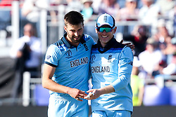 Mark Wood of England celebrates with Eoin Morgan of England after taking the wicket of Matt Henry of New Zealand - Mandatory by-line: Robbie Stephenson/JMP - 03/07/2019 - CRICKET - Emirates Riverside - Chester-le-Street, England - England v New Zealand - ICC Cricket World Cup 2019 - Group Stage