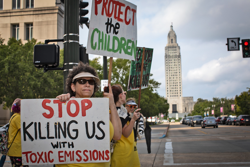 Cindy Russo, an environmental activist with CADA in Baton Rouge protesting in front of the building where the Louisiana Chemical Association (LCA) has its office near the state capitol.