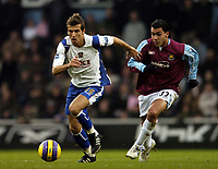 Photo: Olly Greenwood.<br />West Ham United v Portsmouth. The Barclays Premiership. 26/12/2006. Portsmouth's Gary O'Niel and West Ham's Carlos Tevez