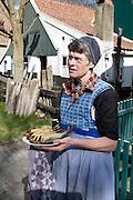 Woman holding fish, Urk village, Zuiderzee museum, Enkhuizen, Netherlands
