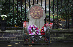 © Licensed to London News Pictures. 19/11/2015. London, UK. Floral tributes grace a memorial to Police Constable Yvonne Fletcher who was killed outside the then Libyan Embassy in St James's Square in 1984. Today a Libyan man has been arrested on suspicion of conspiracy to murder. Photo credit: Peter Macdiarmid/LNP