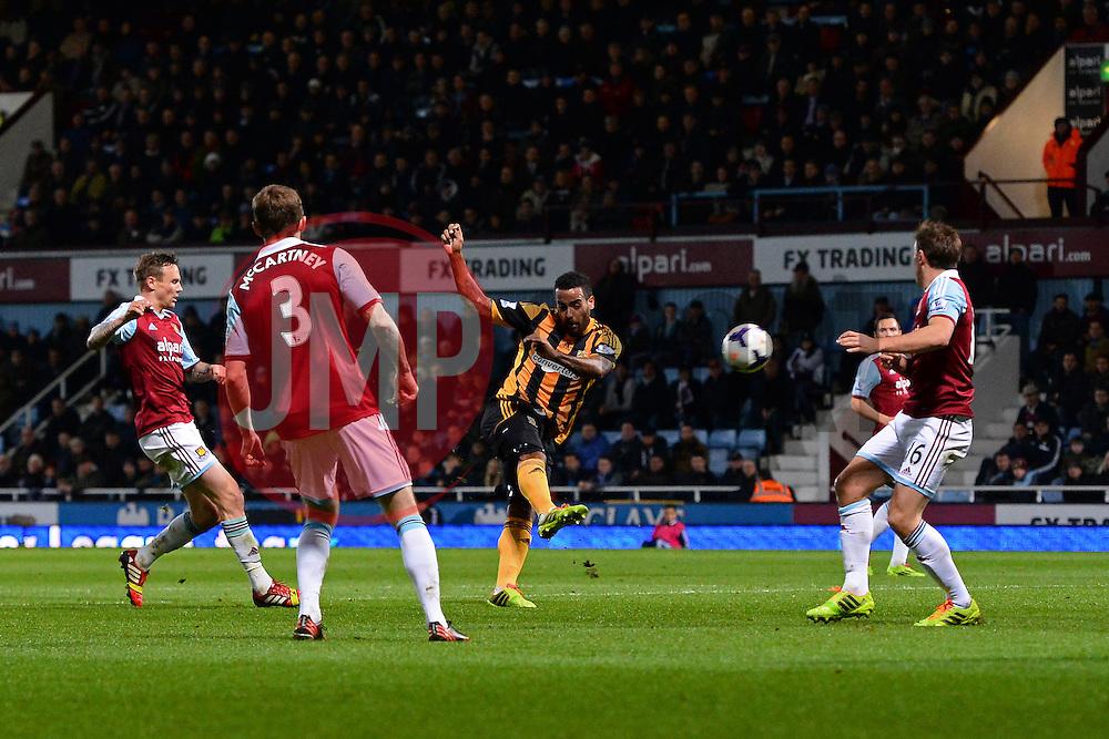 Hull City's midfielder Tom Huddlestone takes a shot at goal - Photo mandatory by-line: Mitch Gunn/JMP - Tel: Mobile: 07966 386802 26/03/2014 - SPORT - FOOTBALL - Boleyn Ground - London - West Ham United V Everton - Barclays Premier League