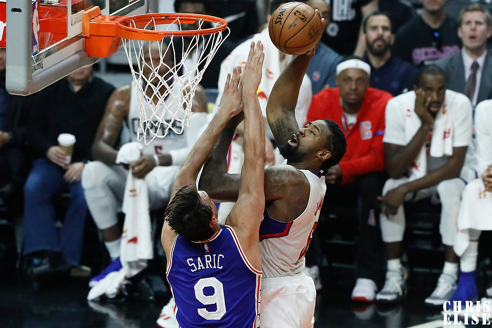 11 March 2017: LA Clippers center DeAndre Jordan (6) goes for the shot against Philadelphia 76ers forward Dario Saric (9) during the LA Clippers 112-100 victory over the Philadelphia Sixers, at the Staples Center, Los Angeles, California, USA.