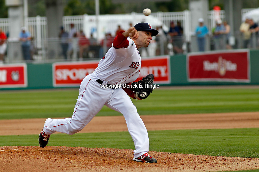 March 15, 2012; Fort Myers, FL, USA; Boston Red Sox relief pitcher Alfredo Aceves (91) throws  during the top of the third inning of a spring training game against the St. Louis Cardinals at Jet Blue Park. Mandatory Credit: Derick E. Hingle-US PRESSWIRE