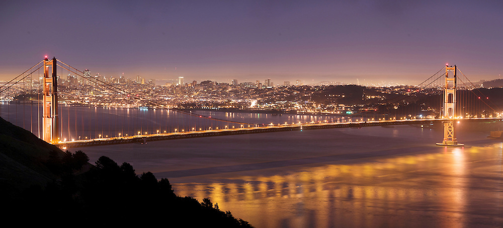 """San Franciso and the Golden Gate Bridge, seen from the Marin Headlands.  Even though a relatively """"green"""" city in a state that pays attention to night lighting, San Francisco is largely not different than an large urban area and puts out a lot of light into the night, creating a night light environment of its own."""