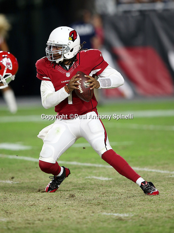 Arizona Cardinals quarterback Phillip Sims (1) scrambles in the fourth quarter during the 2015 NFL preseason football game against the Kansas City Chiefs on Saturday, Aug. 15, 2015 in Glendale, Ariz. The Chiefs won the game 34-19. (©Paul Anthony Spinelli)