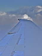 image of clouds and wing from airplane