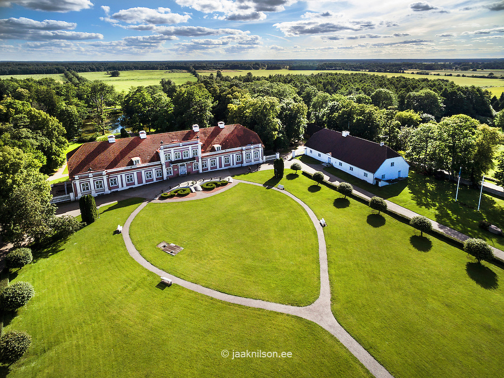 Sagadi manor in Estonia. Aerial view, old castle. Park, trees and buildings, path. Round walkway.