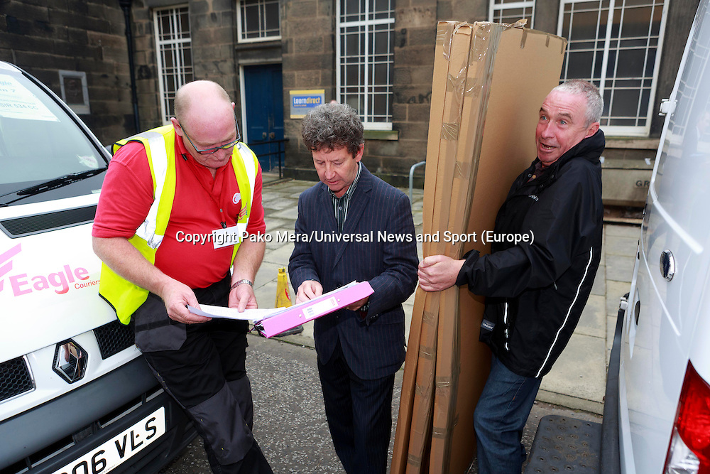 Council workers checking ballot boxes before van leaves.<br /> Ballot boxes delivered. Ballot boxes to be used for voting in the Scottish independence referendum will be picked up by van from storage for delivery to Edinburgh's 145 polling places. .<br /> Pako Mera/Universal News And Sport (Europe)17/09/2014