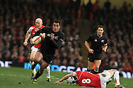 Mils Muliaina of New Zealand makes a break to score his try. Invesco Perpetual match, Wales v New Zealand at the Millennium stadium in Cardiff on Sat 27th Nov 2010.  pic by Andrew Orchard, Andrew Orchard sports photography,