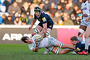 Saracens flanker Michael Rhodes (6) offloads in the tackle  during the Aviva Premiership match between Wasps and Saracens at the Ricoh Arena, Coventry, England on 7 January 2018. Photo by Simon Davies.