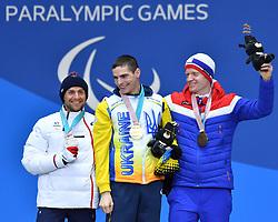 DAVIET Benjamin FRA LW2, REPTYUKH Ihor UKR LW8, OLSRUD Hakon NOR LW8, ParaSkiDeFond, Para Nordic Skiing, 20km, Podium at  the PyeongChang2018 Winter Paralympic Games, South Korea.